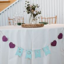 I painted this banner using a kit purchased from Joann; someone had the brilliant idea to use it at our sweetheart table!