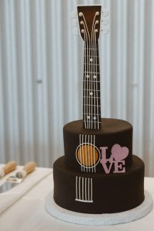 """I painted the """"Love"""" piece, which went perfectly with the grooms' cake."""